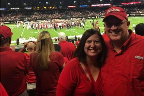 Jennifer Taylor and Spouse at UL Bowl Game